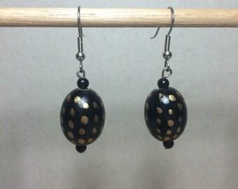 Painted wooden earrings.