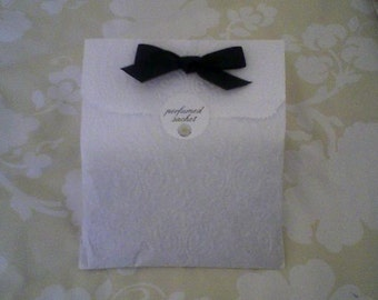 Perfumed Sachet in embossed paper bag