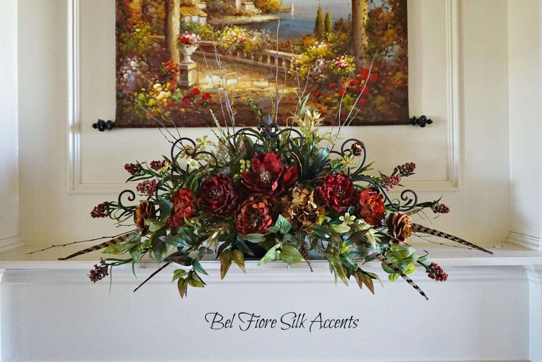Tuscan fireplace mantle centerpiece floral arrangement