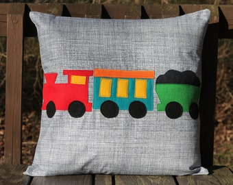 Train appliqued pillow cover