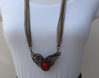Steampunk necklace with five chains, hand wired cogs and pretty red glass stone