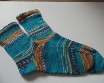 Hand cranked socks made on a Circular Sock Machine