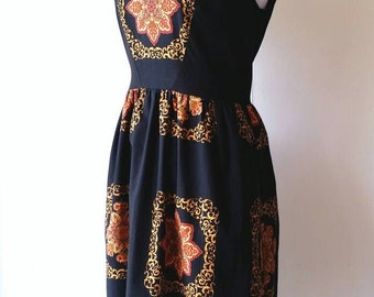 Black and Gold Paisley Dress with Gathered Waist and Triangle Cut-Out on Back