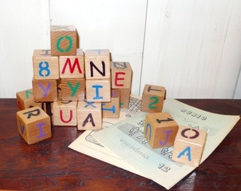 Educational alphabet and numbers building blocks. Construction game. Wooden toys