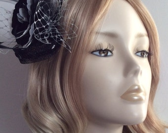 BLACK, WHITE and SILVER Fascinator, Made of sinamay, Organza flower, sequins,Metallic net,feathers, on a clip