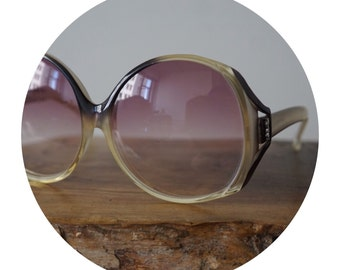 Yves Saint Laurent Oversized Round Purple Tinted Sunglasses