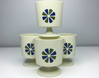 set of four vintage David Douglas off-white plastic pedestal cups footed tumblers
