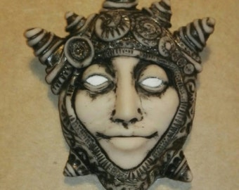OOAK brooch, polymer clay. Royal face.