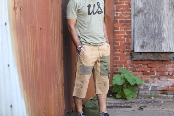 CL patched khaki twill shorts