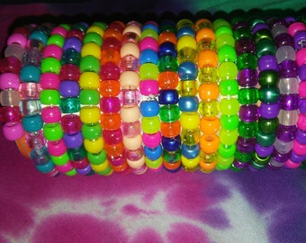 15 assorted kandi bracelets