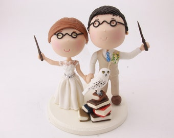 Magical Couple holding wands with pet owl - Harry Potter Theme Wedding cake topper. Wedding figurine.  Handmade. Fully customizable.