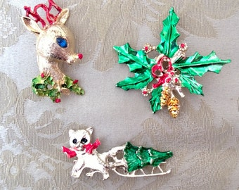 Christmas brooch trio, reindeer, kitten, and holly spray, gold tone with enamel details