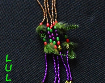 Cali, breastplate necklace beads and feathers