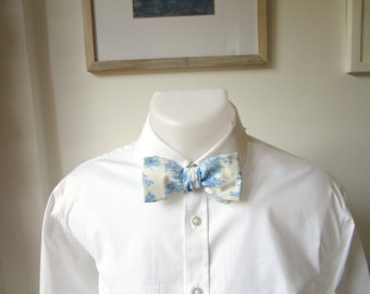 Bowtie.  A classic freestyle, self-tie bow tie in an historical French country design.  Blue on a White background.  Ships Worldwide.