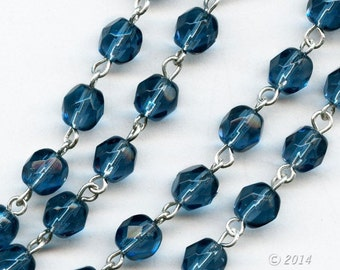 """Czech chain of Montana blue faceted glass beads and silver wire.   6mm faceted rounds.  Sold in 36"""" lengths. b12-chn684(e)"""