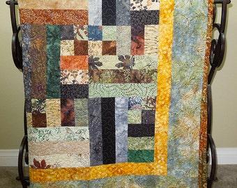 "Road to Bali Quilt - 52.5"" X 63"" - Neutral earth tone batik colors and batik brown binding/green and gold batik back."