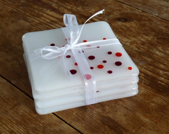 Handmade Glass Coasters. Set of four, red dotty design. Designed and made in the UK.