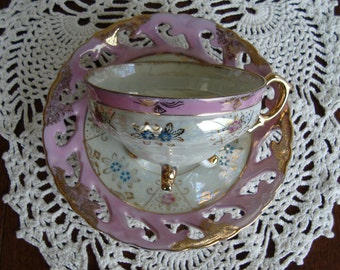 Made in Japan Hand Decorated  - Vintage 3-Footed Tea Cup and Laced Saucer - Pink, Blue and Gold Floral on Pearled Background with Pink Band