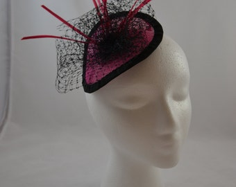 Hot pink fascinator on sinamay disk with veiling & feathers