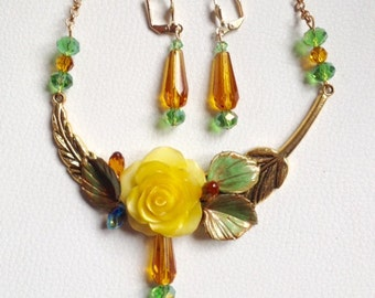 Beautiful yellow and green ornament made of cold porcelain and gold metal