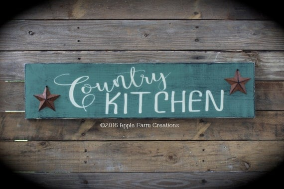 large wooden country kitchen sign with rusty stars sage green