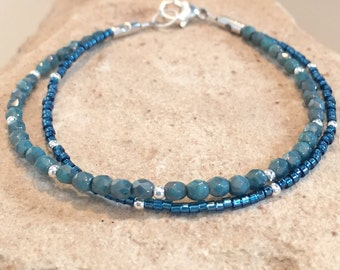 Beautiful blue double strand bracelet made with Czech glass beads, Miyuki seed beads and sterling silver round beads with a trigger clasp
