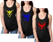 Pokemon Go. Team Valor. Team Mystic Team. Instinct. Pokeball. nerd. Black Ladies Tank Top. **LIMITED SUPPLIES ** for Women