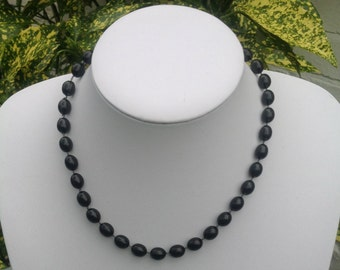 Vintage black bead necklace with silver tone clasp