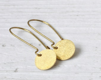 Gold plated earrings with brass dots