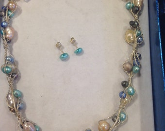 Sterling silver jecklace and earrings with fresh water pearls