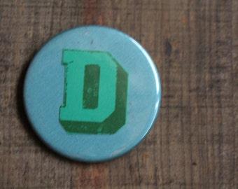 Letter D alphabet badge