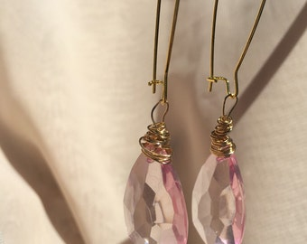 Pink and gold colored dangle earrings