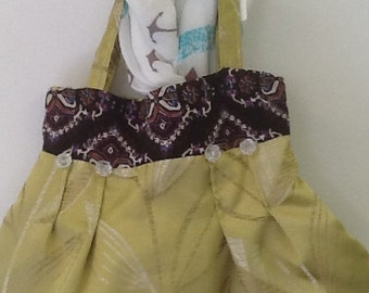 Lime green tote bag with Aztec trim and clear rose beads to front and back