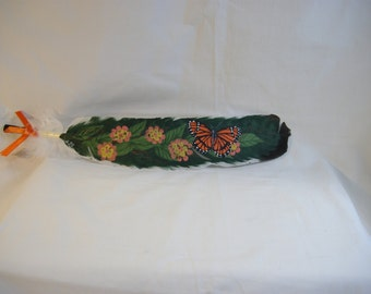 Hand painted feather with orange butterfly
