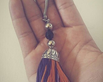 Purple and orange tassel keychain with detailed cap and beads