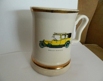 Prince William mug - rare, 22carat gold, with a rolls-royce car picture.
