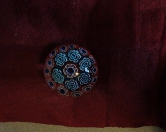 red white and blue millefiori paper weight