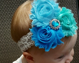 Gorgeous! 3 blue flowers set on stretch lace.