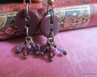 Purple button earrings with purple glass crystal clusters, on antique copper wire