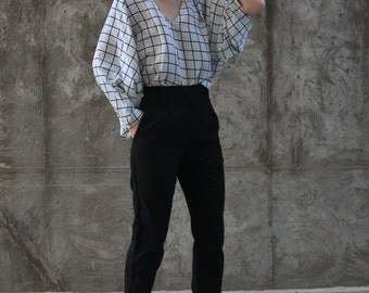 "Oversized batwing shirt with ""V"" neckline shape"