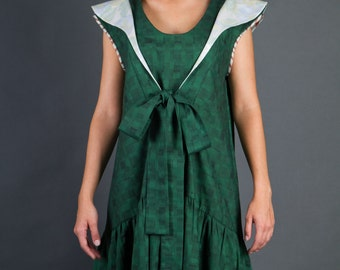 Green dress with bow and ruffles, retro style