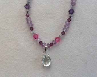 String of pearls of amethyst, swarovski crystal beads and a Crystal pendant.