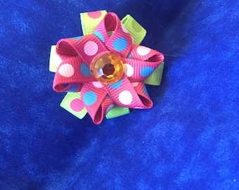 Pink and green dotted hair bows
