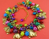 Rainbow Jingle Bell Christmas Charm Bracelet - festive holiday bracelet with multi coloured bells and vintage brass stamping bells with bows