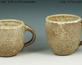 Pair of handmade mugs cups with textural glazes. c158, 159