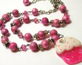 Kawaii Pink Cupcake Necklace with various pink beads and clear rhinestones