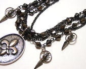 Spiked Fleur de Lis Necklace - Gunmetal and silver layered chain necklace with ornate spike charms - Elegance with Edge Necklace