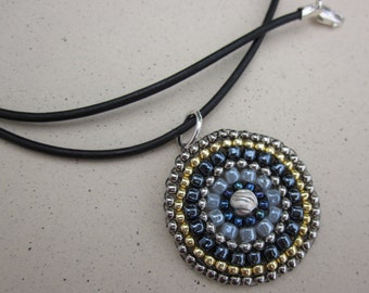 black, silver and gold seed bead medallion necklace on black leather cord