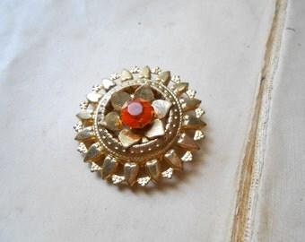 vintage brass flower brooch with topaz rhinestone - costume jewelry