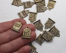 Brass Gravestone Charms 2 Or More TierraCast Grave Head Stone Brass Oxide Plated Lead Free Pewter Halloween Cemetary R.I.P. Never More Raven